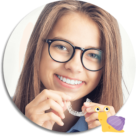 young girl inserting her Invisalign clear aligners