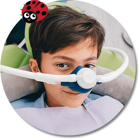 young boy wearing a nitrous oxide sedation mask